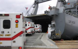 ambulances-go-up-ramp-into-ship