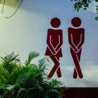 female-and-male-restroom-icons-looking-like-they-have-to-pee