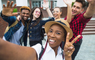 diverse-high-school-students-pose-for-selfie