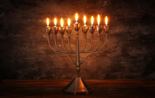 a-lighted-menorah-shines-in-the-dark