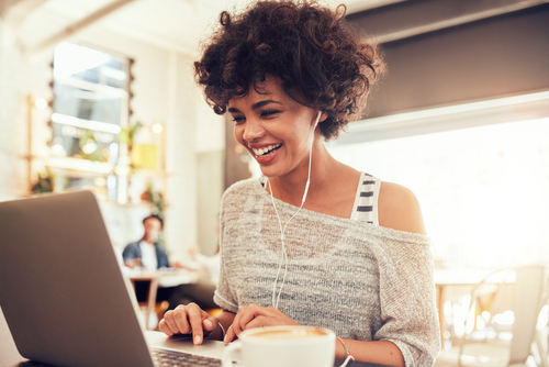 laughing-woman-working-at-laptop